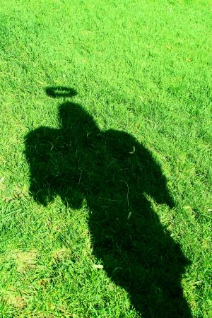angel shadow on grass